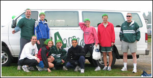 Image of the team, the Avocados, in front of their team van